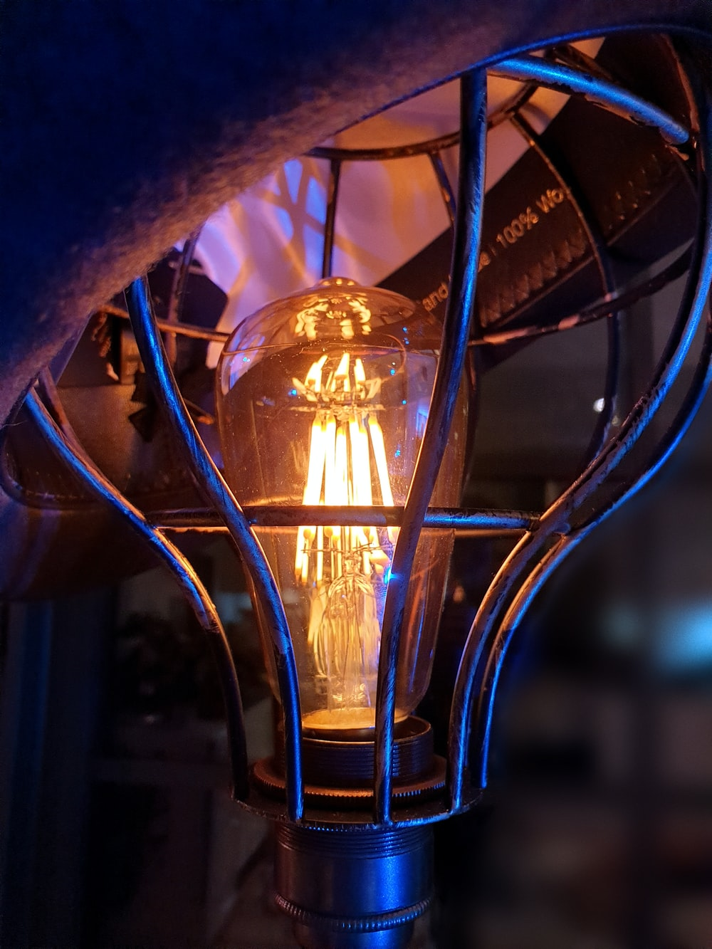 yellow light bulb turned on in close up photography