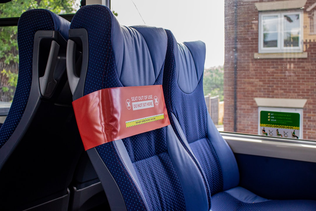 Social distancing stickers and vinyls from onboard a Bluestar bus in Southampton, UK. Passengers can only sit at the window seats with alternate rows of seats blocked out of action. Coronavirus has severely affected seating capacity on all buses in England.