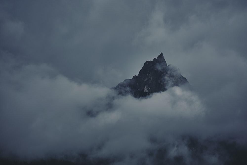 black mountain under white clouds