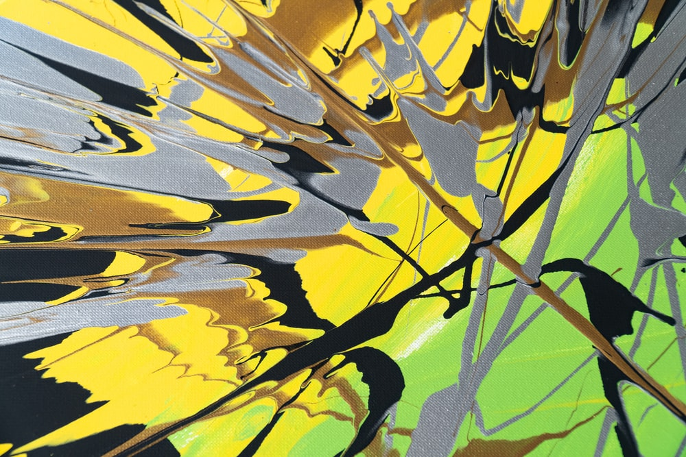 yellow and black leaf in close up photography