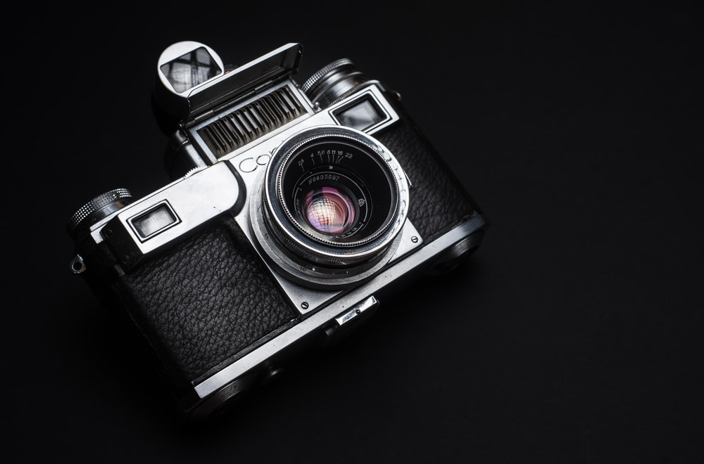 black and silver dslr camera