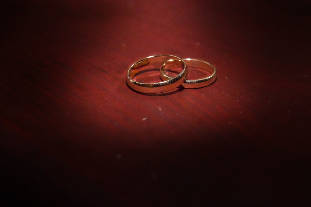 silver ring on brown wooden table