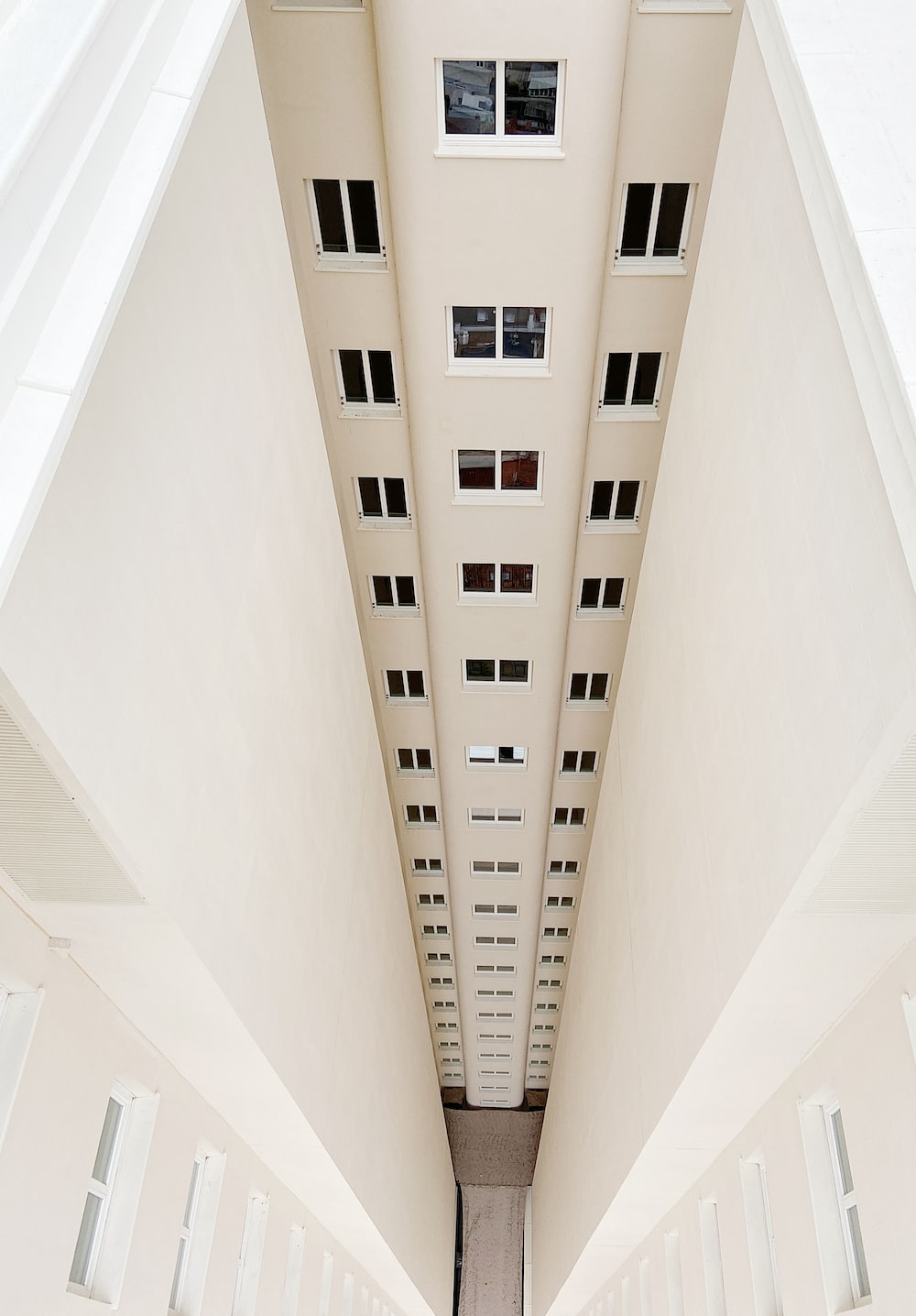 white concrete building with white ceiling