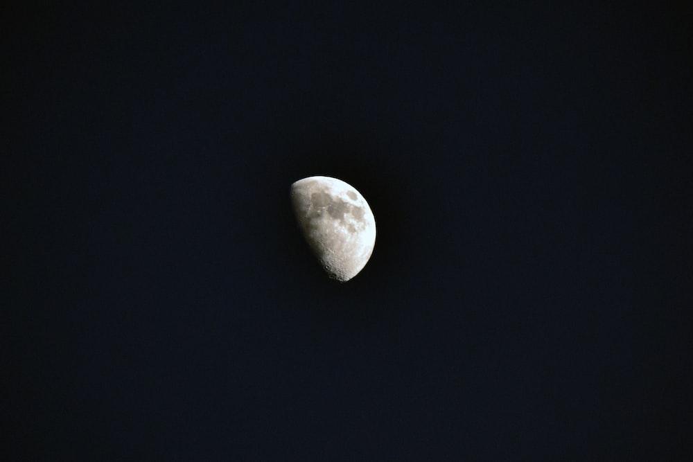 white heart shaped stone on black surface