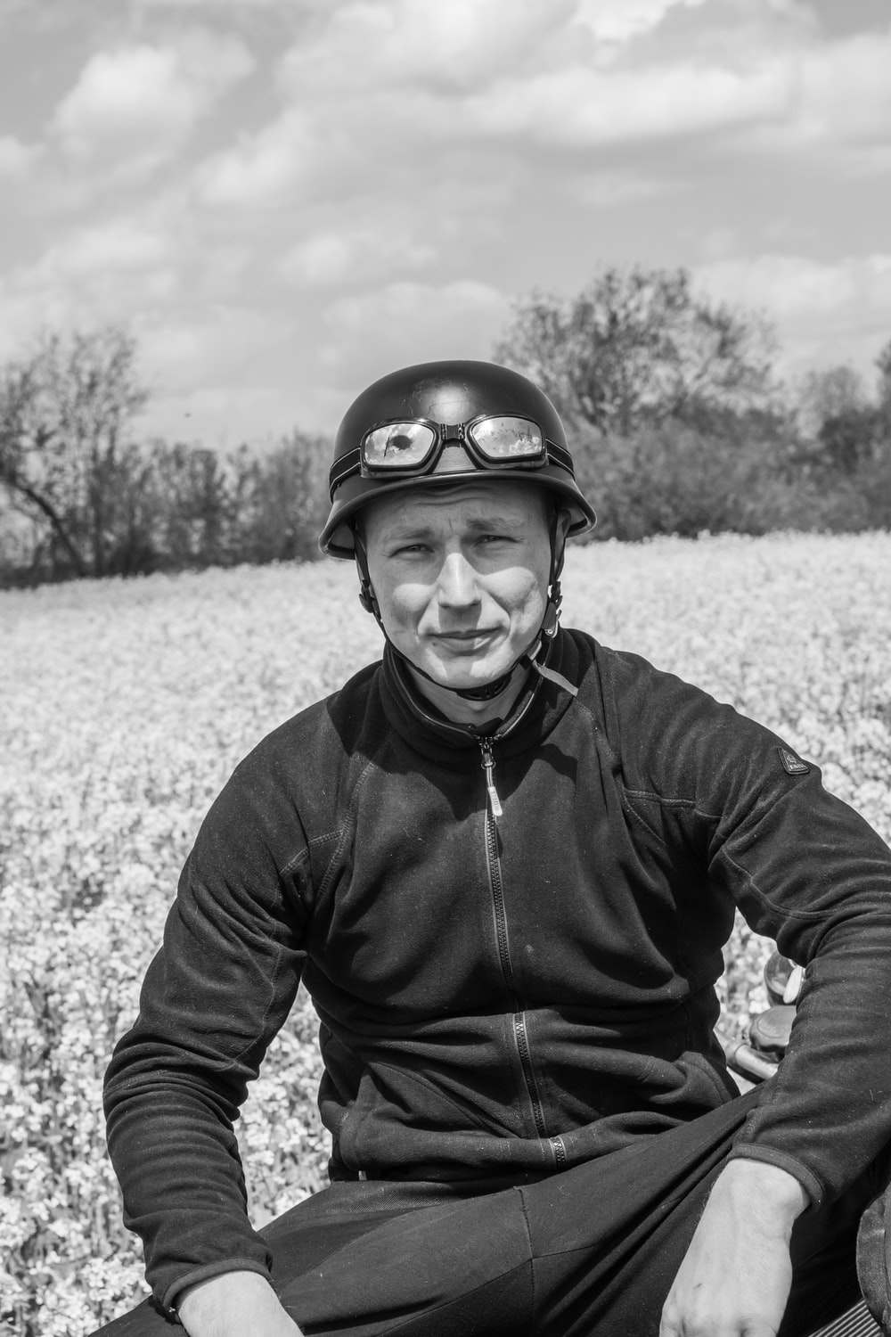 man in black jacket and helmet in grayscale photography