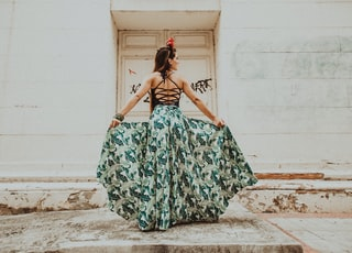 woman in green and white floral tube dress