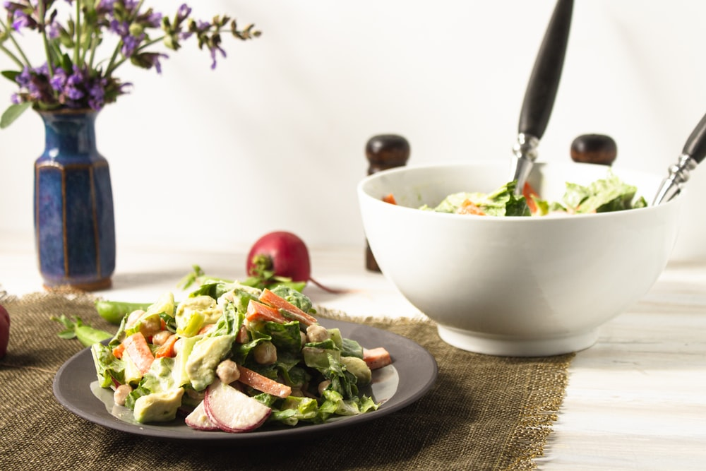 vegetable salad in white ceramic bowl