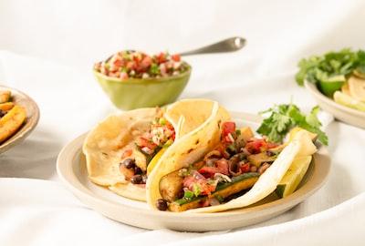 vegetable salad on white ceramic plate taco zoom background