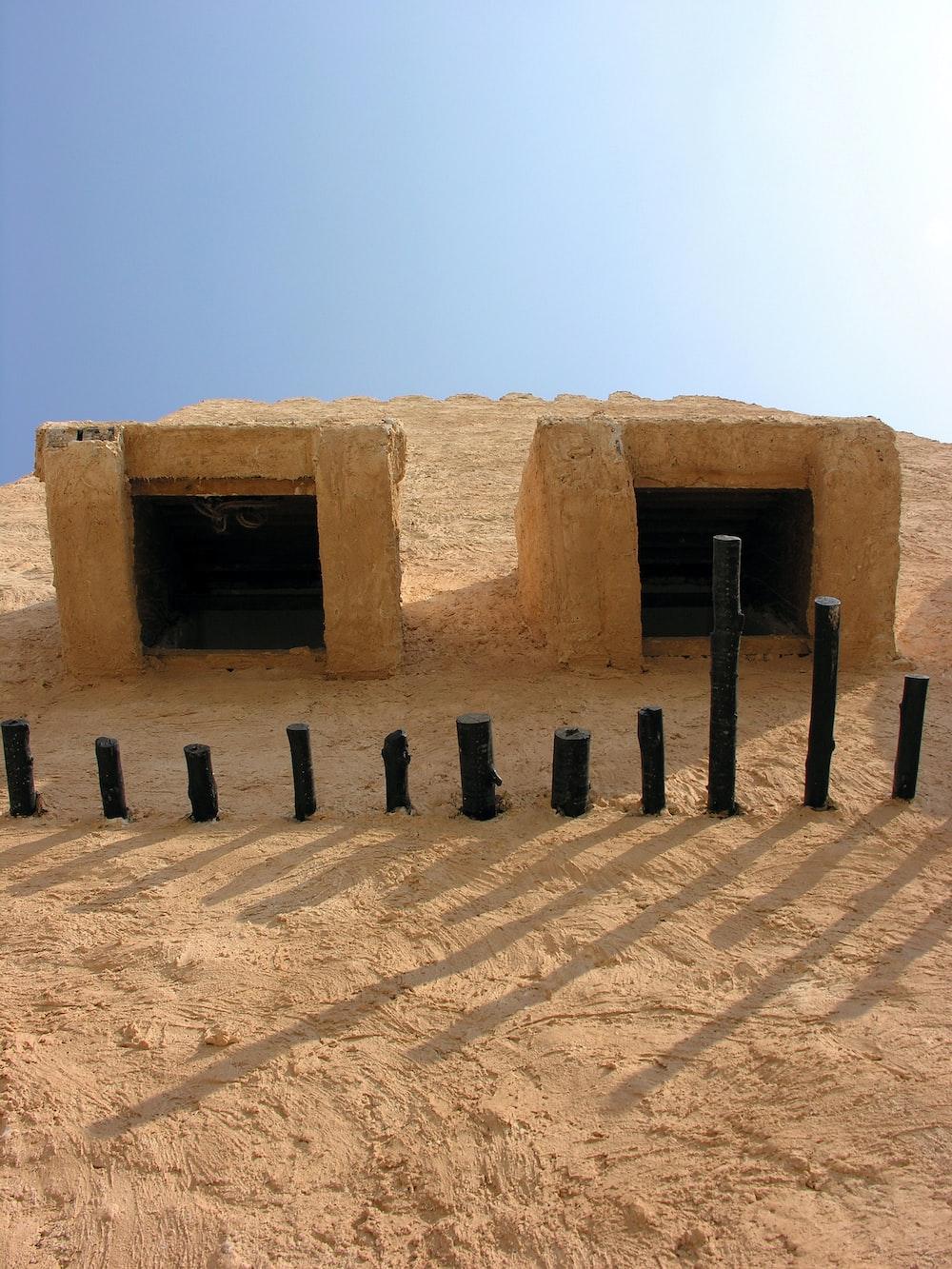 brown concrete blocks on brown sand