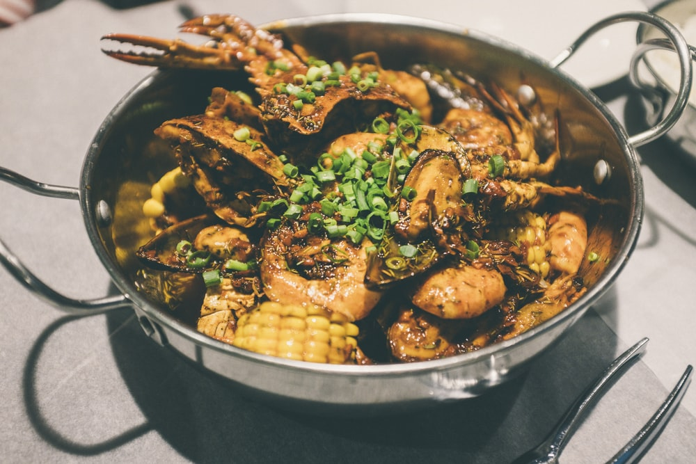 cooked food on black cooking pan