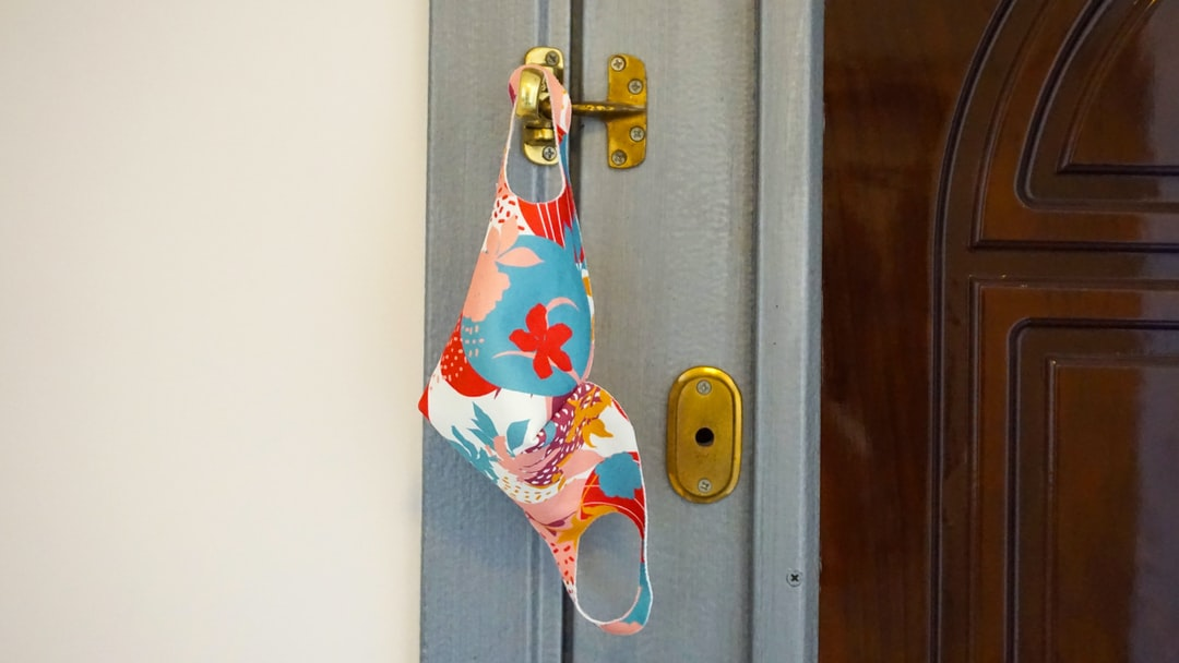 Handmade face mask hanging on the door. colorful mask to protect against corona virus Covid-19. Stay home: New normal lifestyle