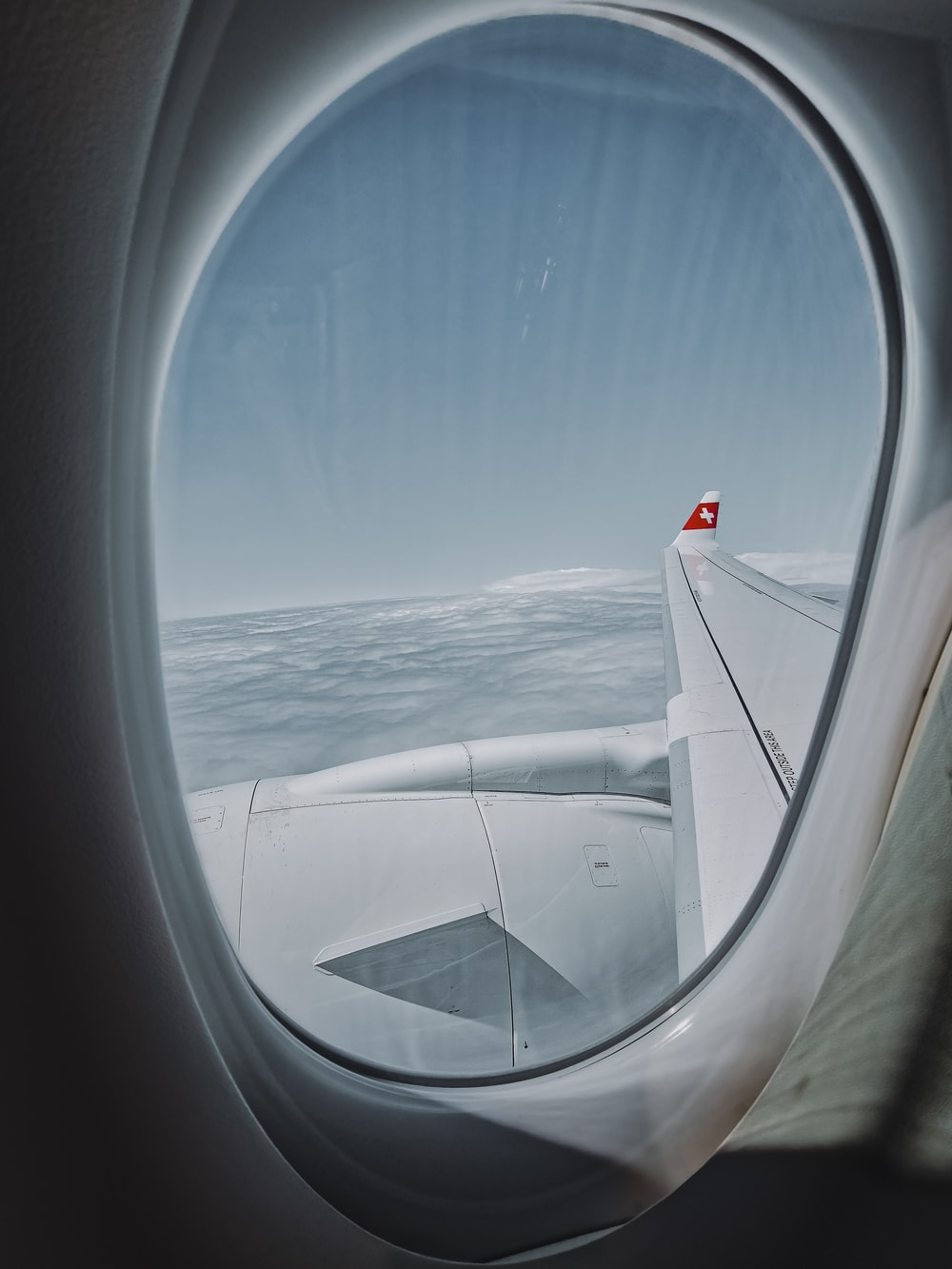 white airplane wing over the sea during daytime