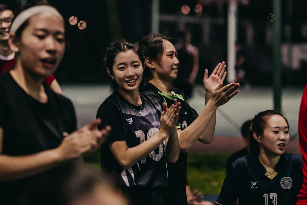 man in black crew neck t-shirt standing beside woman in black crew neck t-shirt