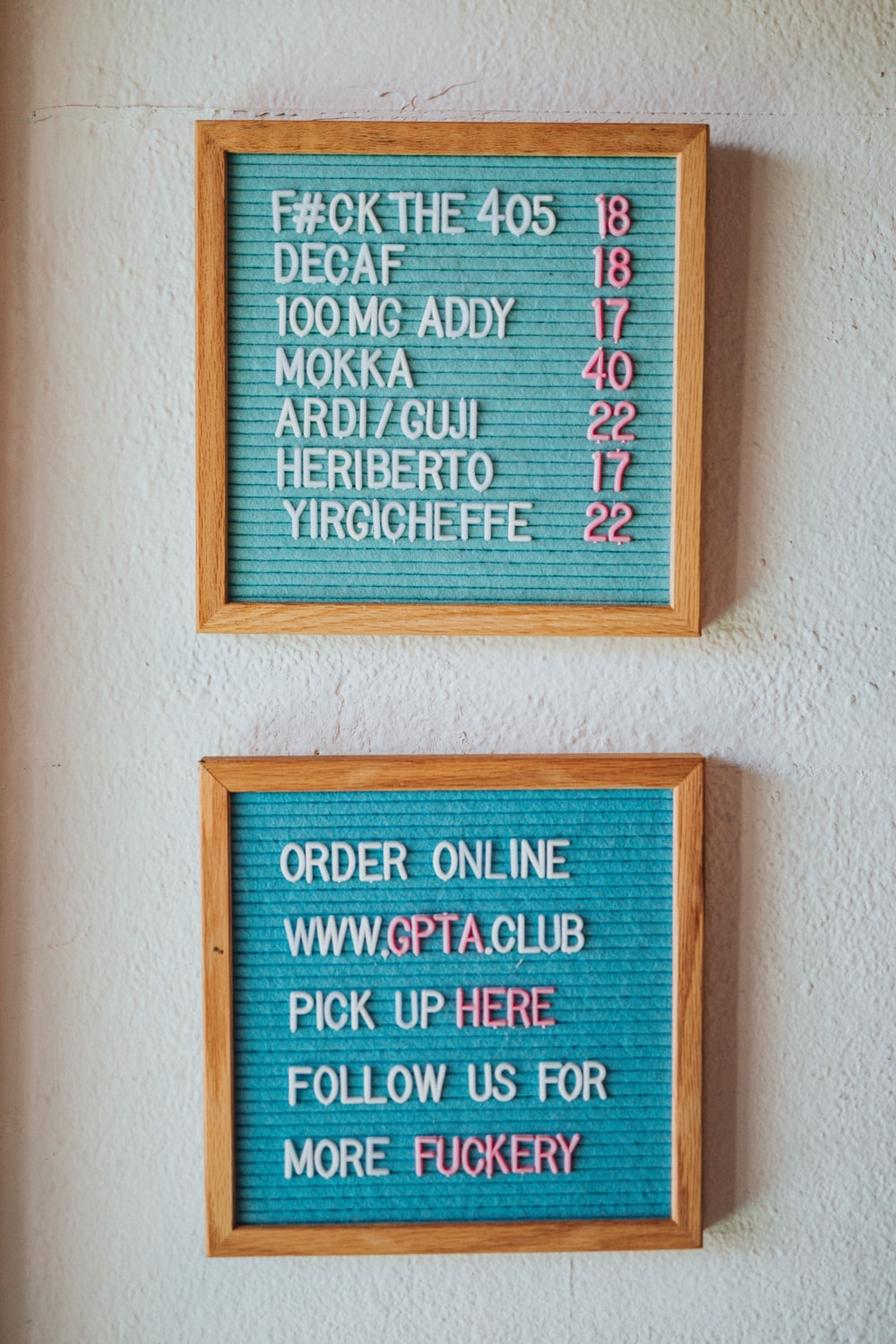 brown wooden wall mounted quote board