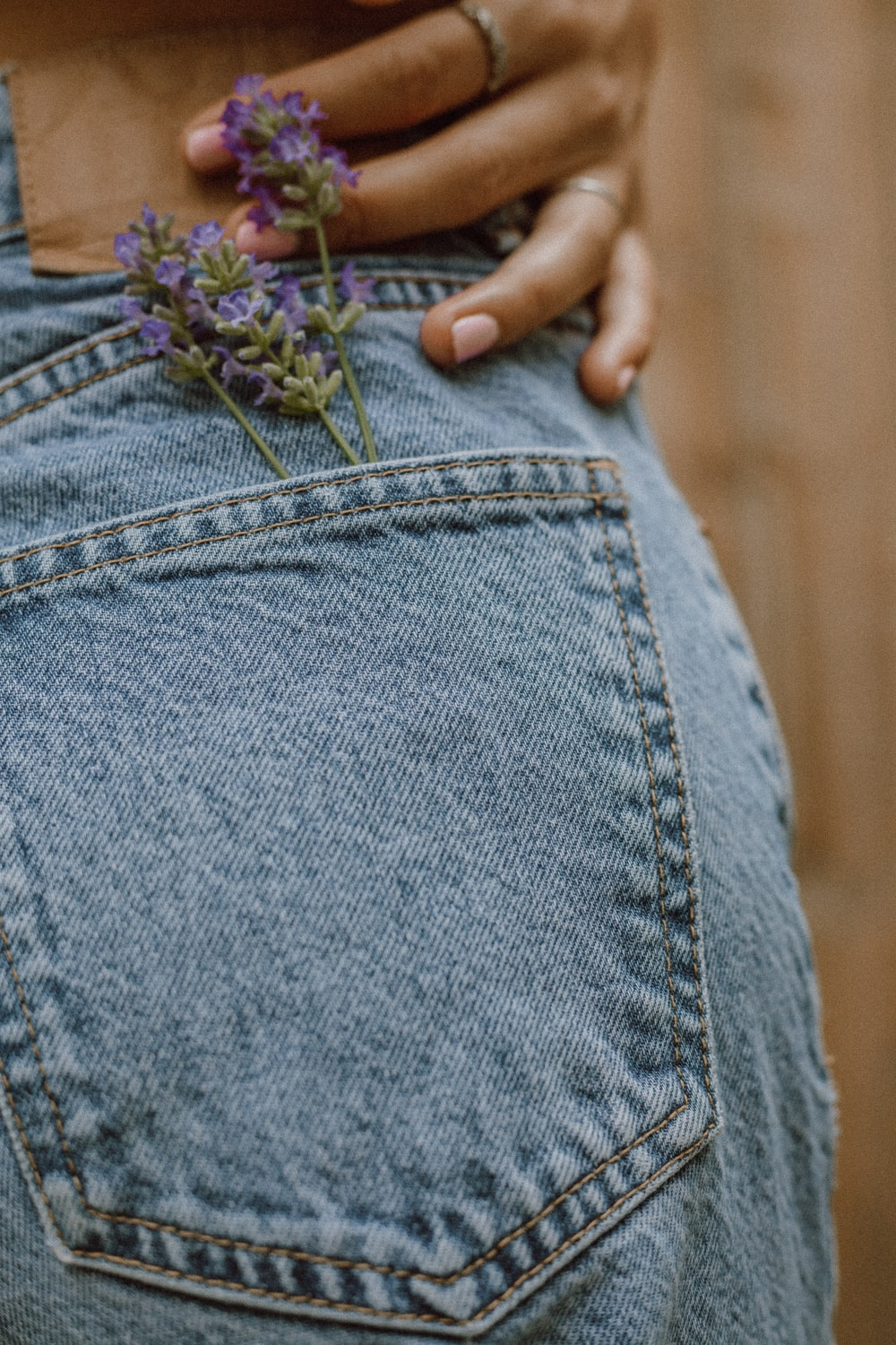 person in blue denim jeans