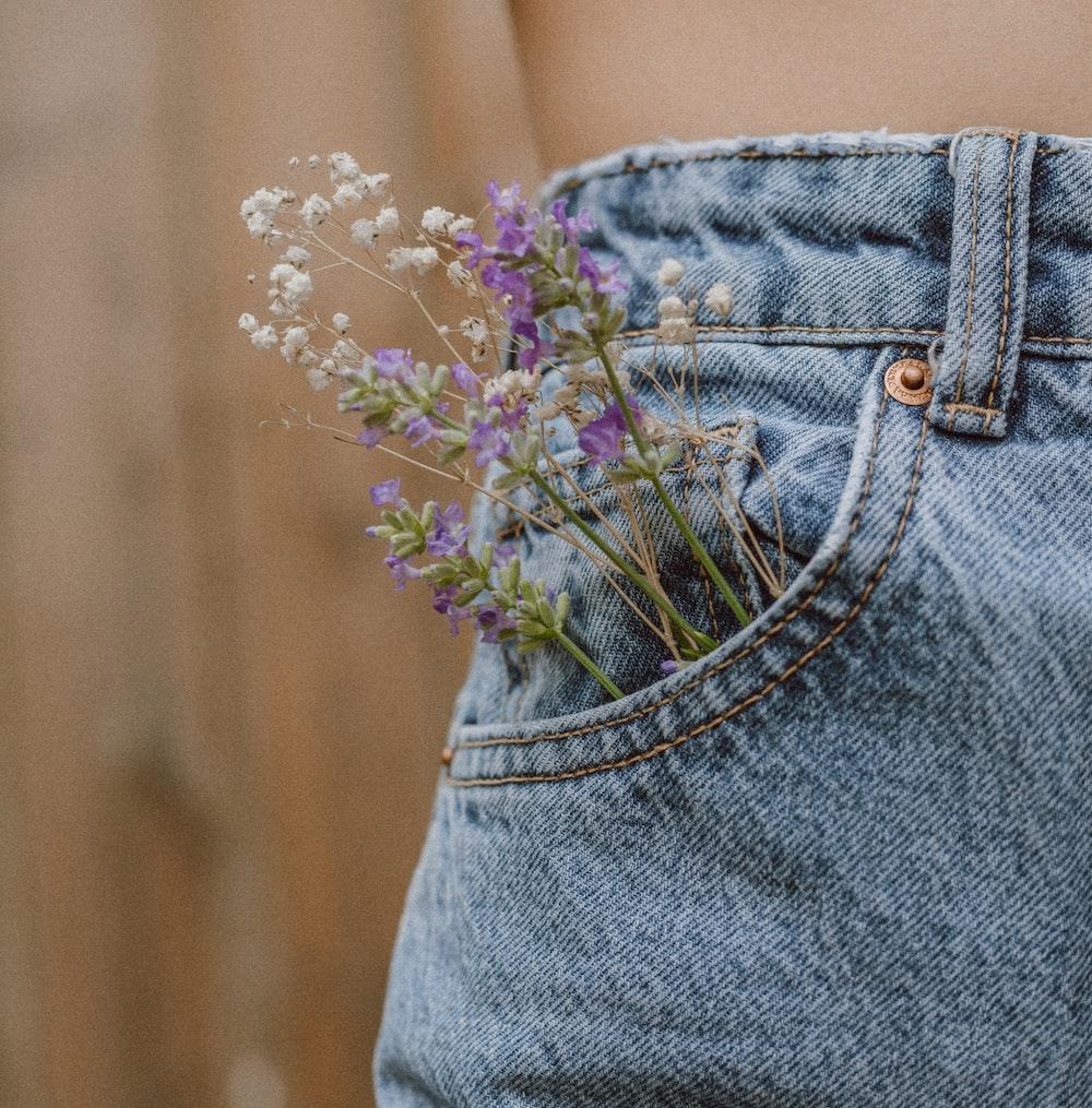 purple flower on blue denim shorts