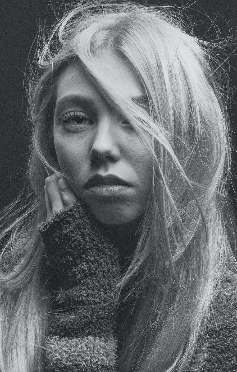 woman with blonde hair wearing black and white scarf