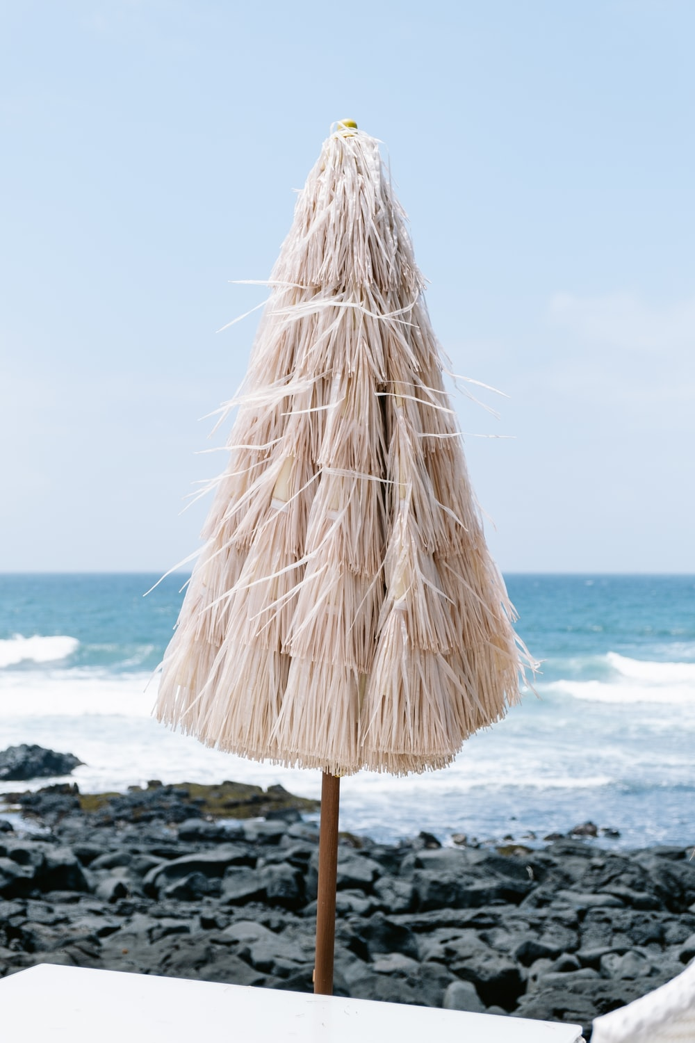 brown wooden stand on beach during daytime