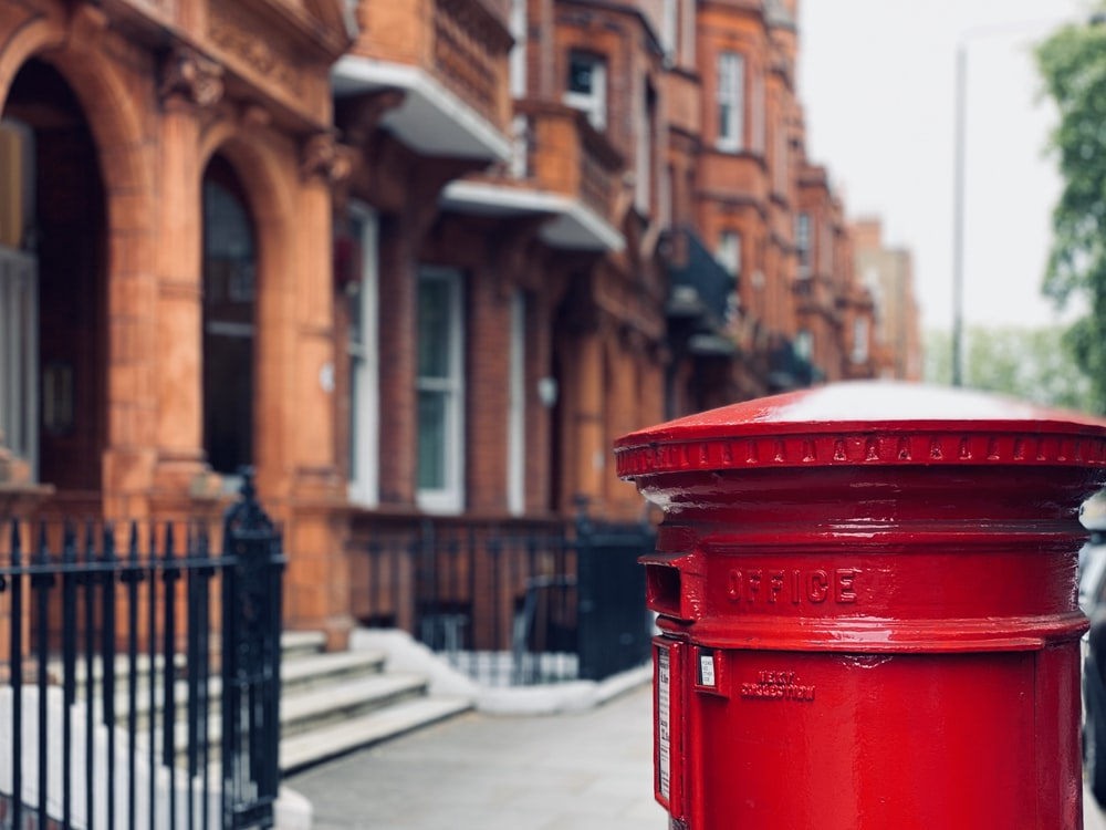 red mail box on street during daytime