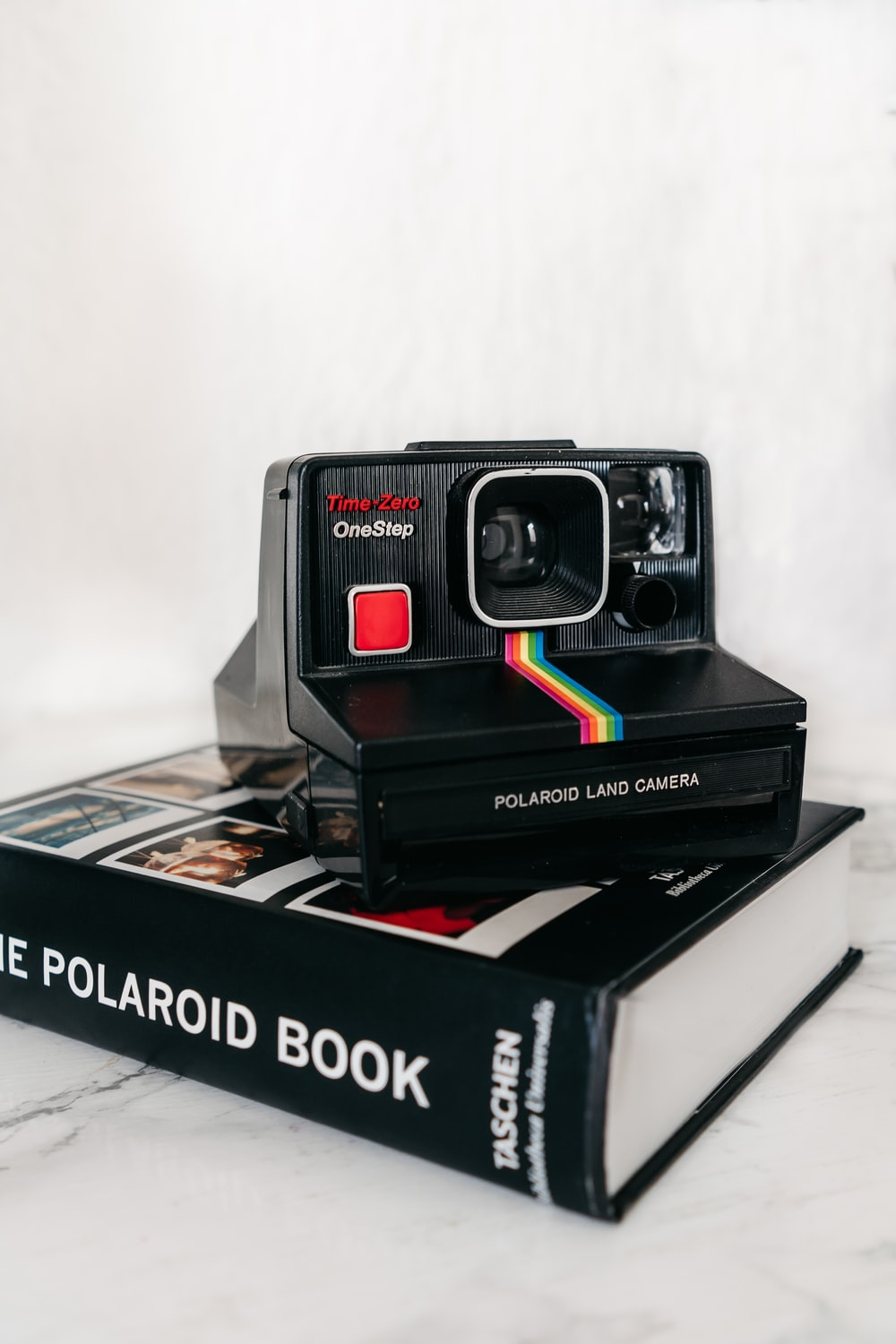 red and black polaroid camera