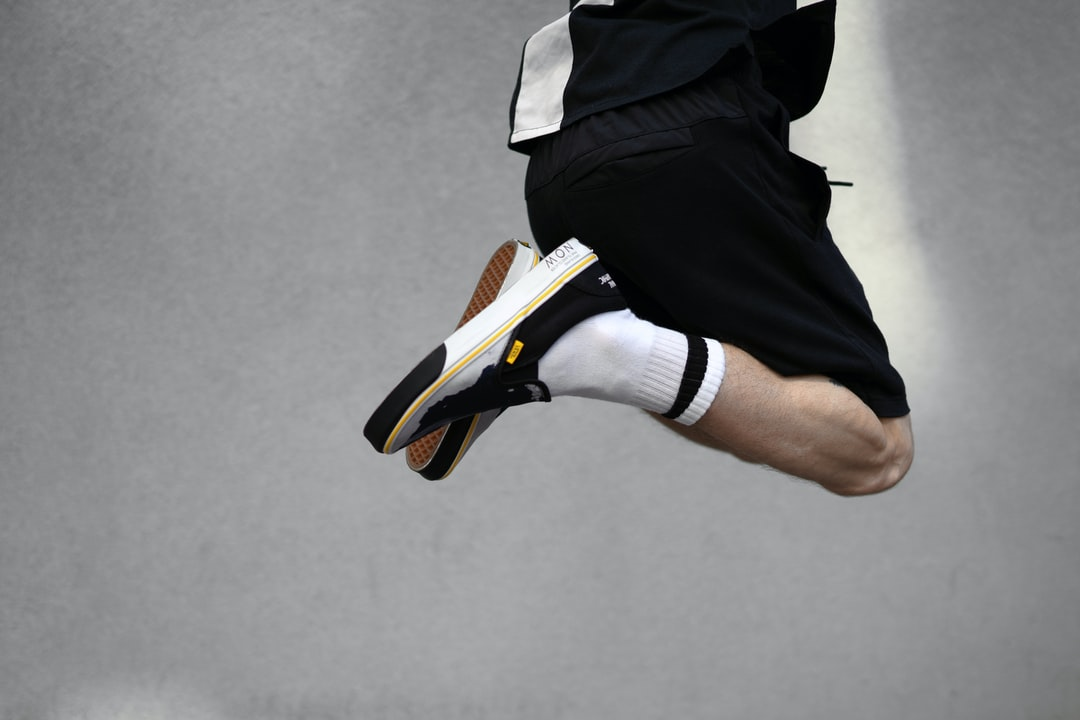 Person In Black and Orange Nike Athletic Shoes - unsplash