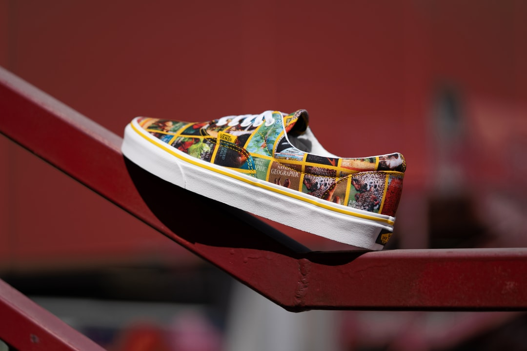 White Red and Yellow Nike Athletic Shoes - unsplash
