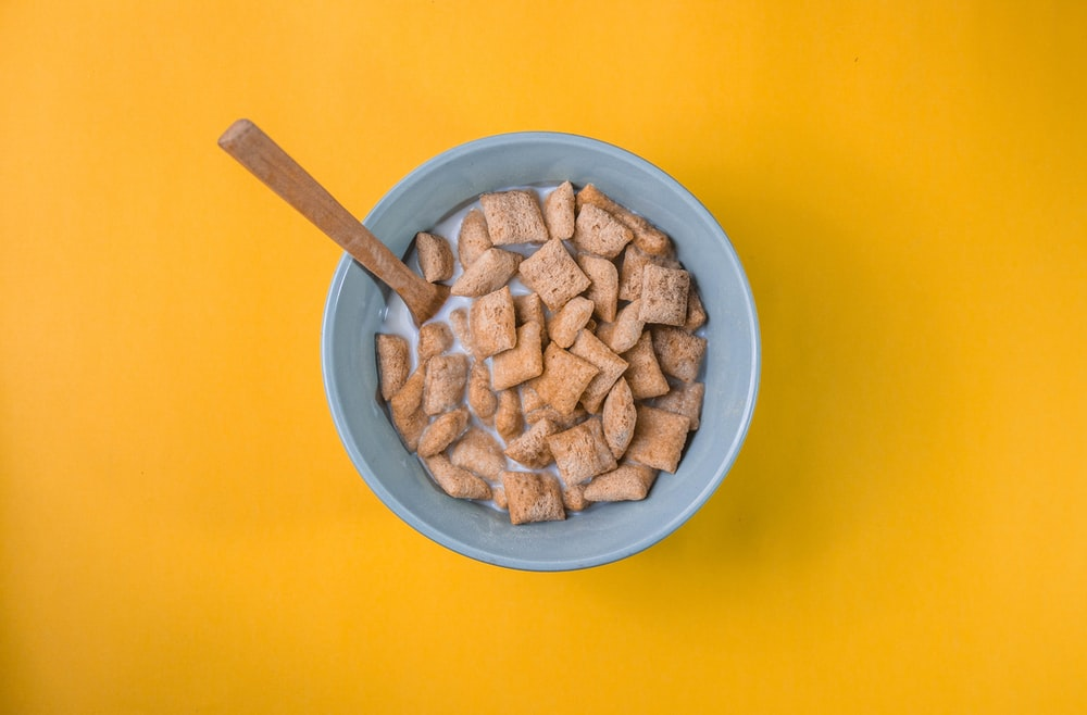 brown peanuts in blue ceramic bowl