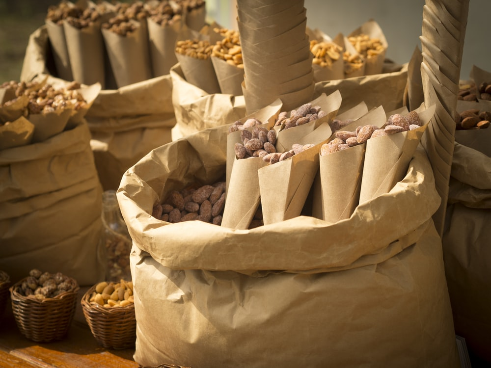 brown paper bags with white and pink ice cream