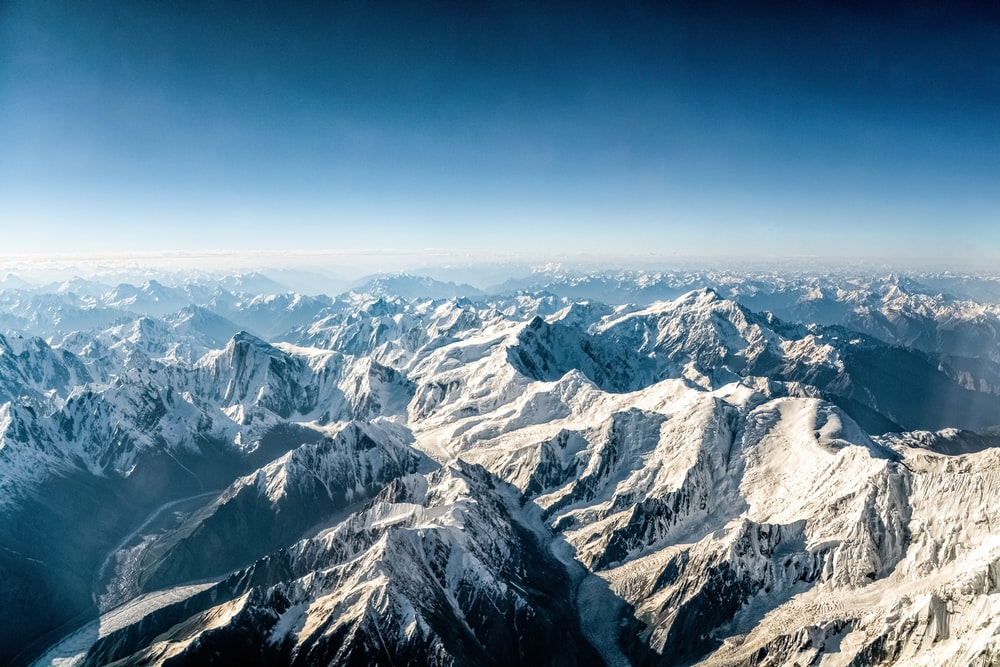 aerial view of snow covered mountains during daytime