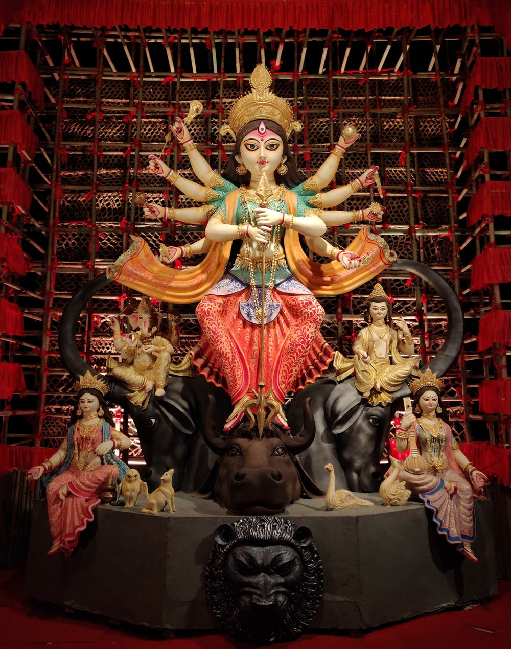 hindu deity statue on brown wooden table
