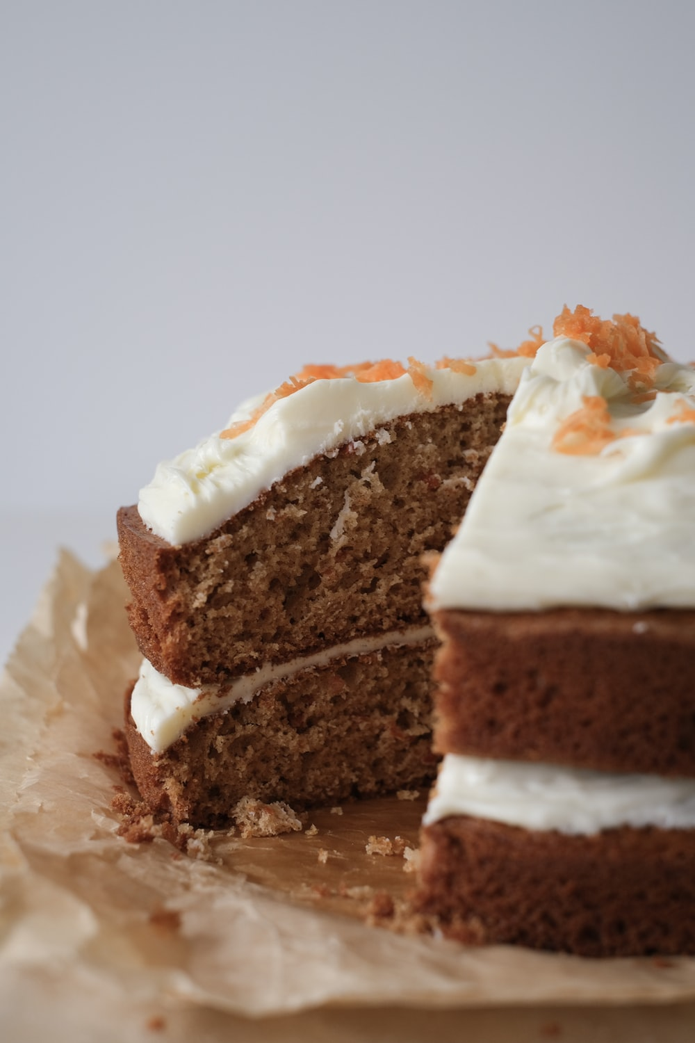 brown and white cake on white paper