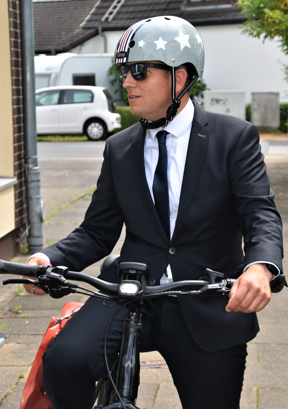 man in black suit riding on motorcycle
