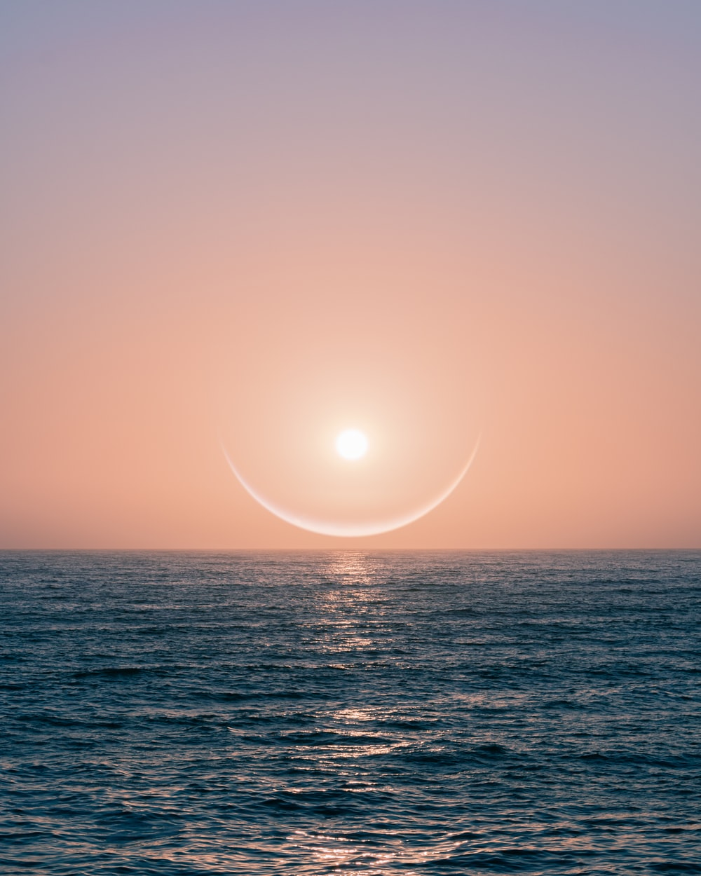 sun over the sea during sunset