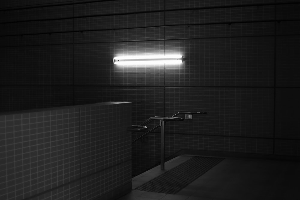 white ceramic tiled wall in grayscale photography