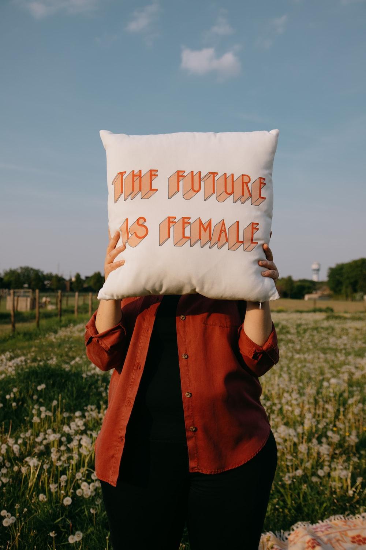 person holding white happy birthday throw pillow
