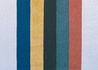 blue yellow and red striped wall decor