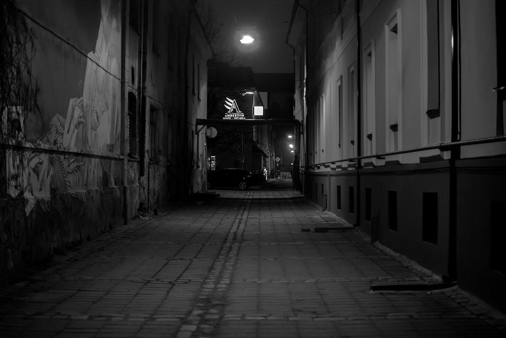 grayscale photo of empty hallway