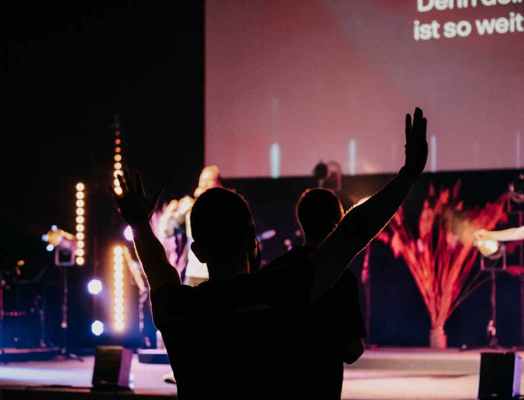 guy raising his hands in worship
