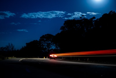Canberra time lapse photography of cars on road during night time