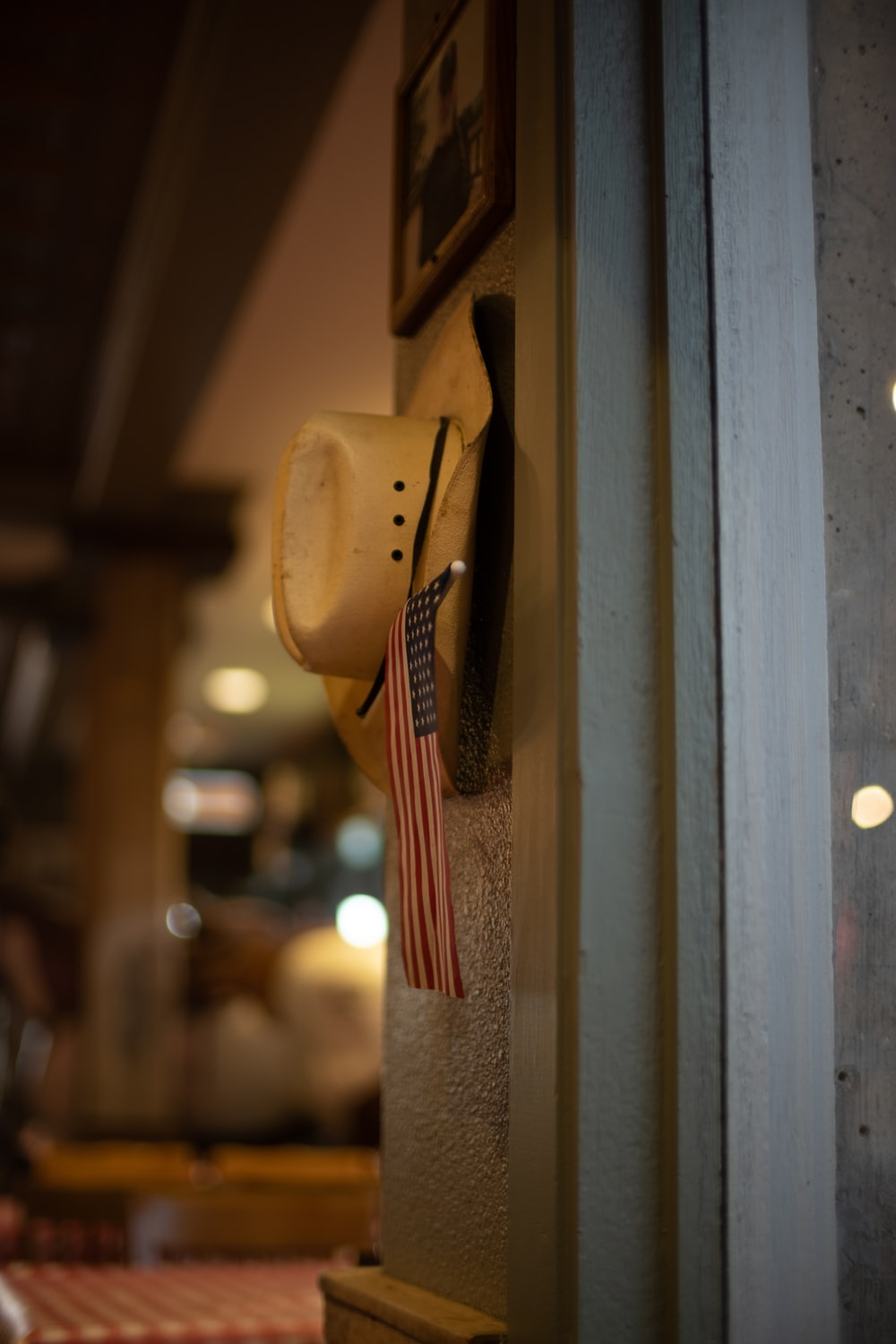 brown cowboy hat hanged on brown wooden wall