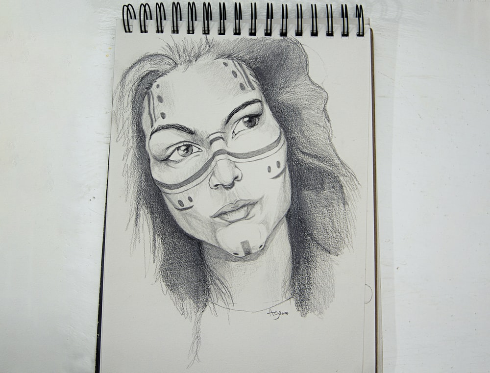 womans face sketch on white paper
