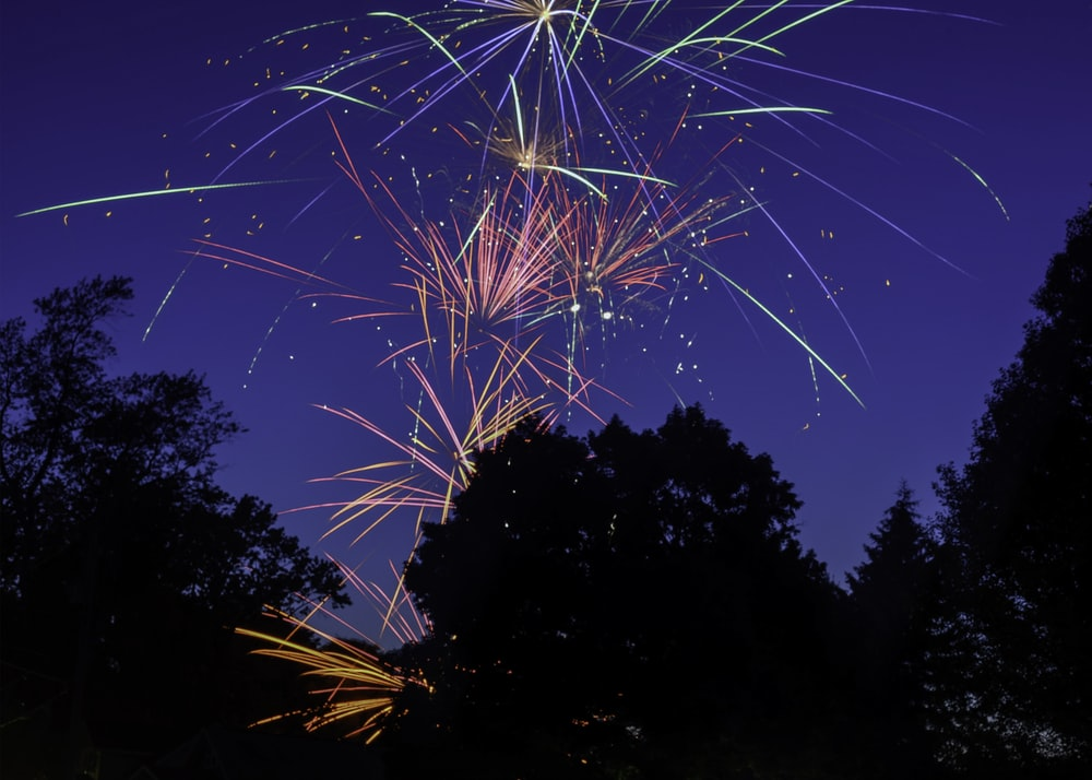 white and blue fireworks during night time
