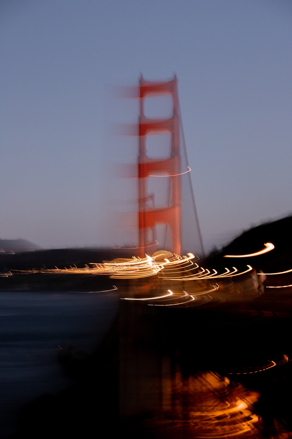 brown boat on water during night time