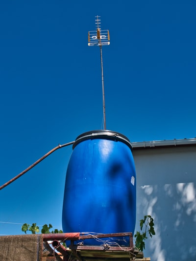 blue barrel with antenna