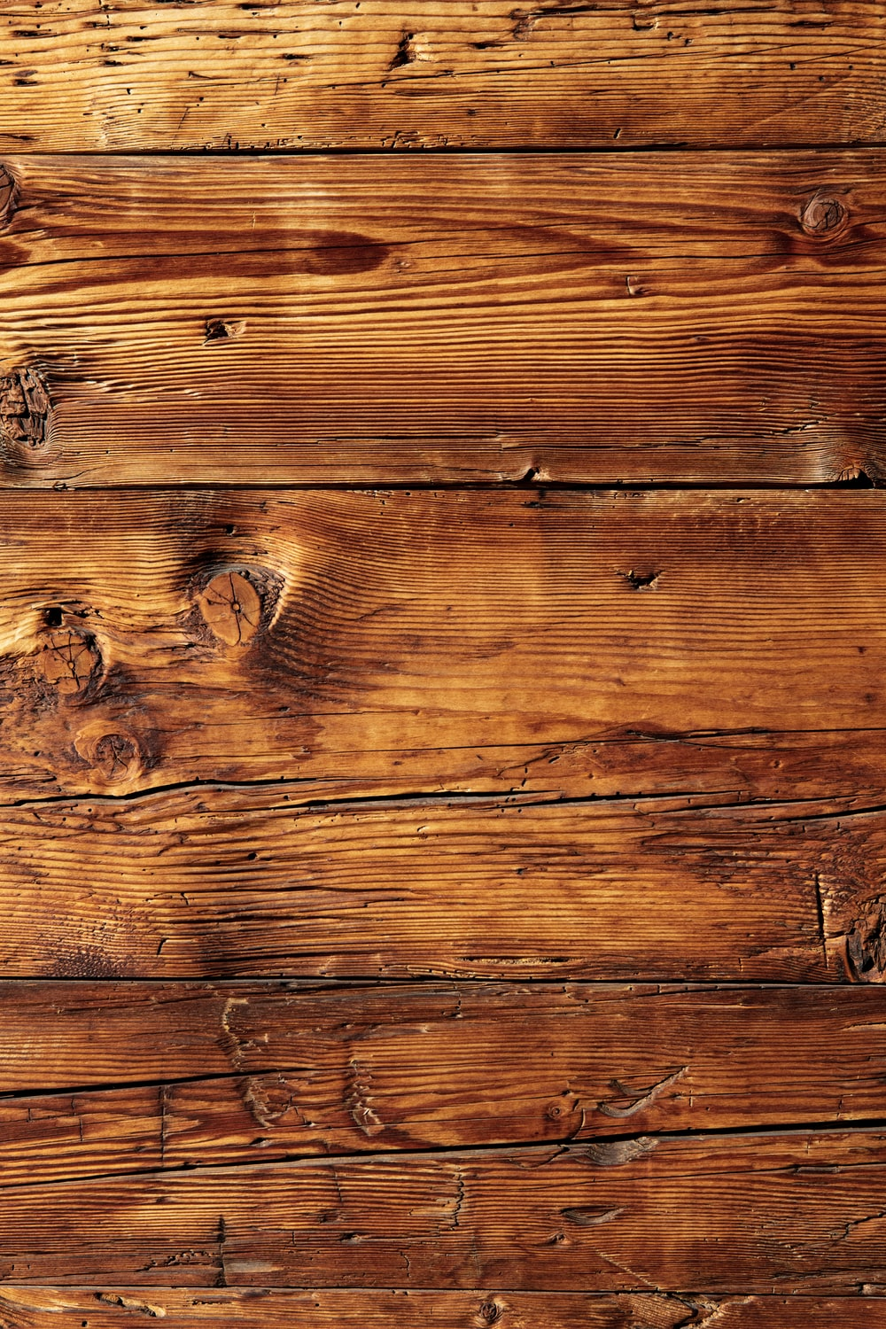 brown wooden plank with white paint