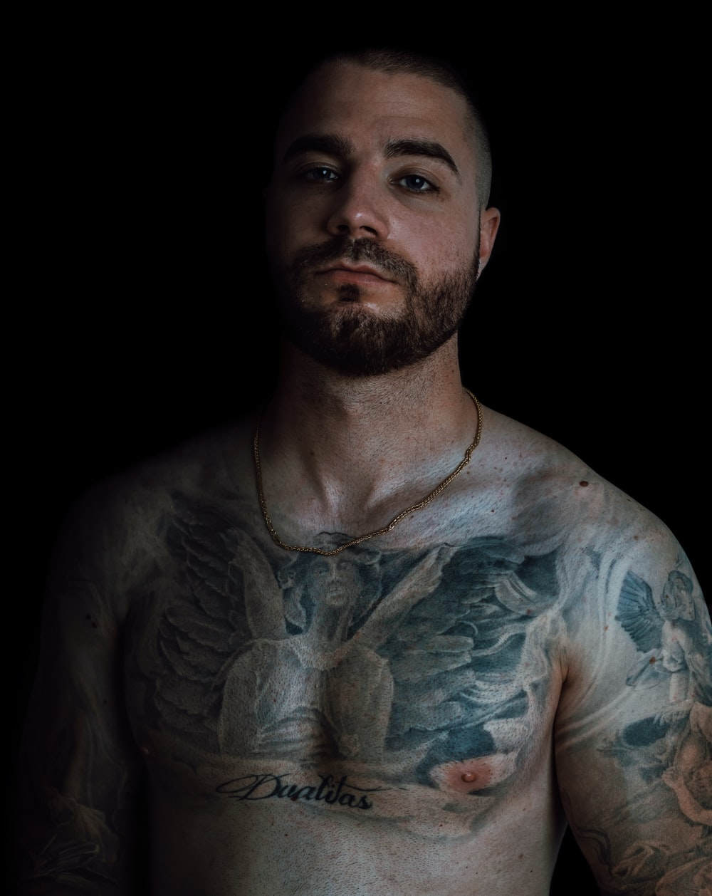 man with white and blue body tattoo