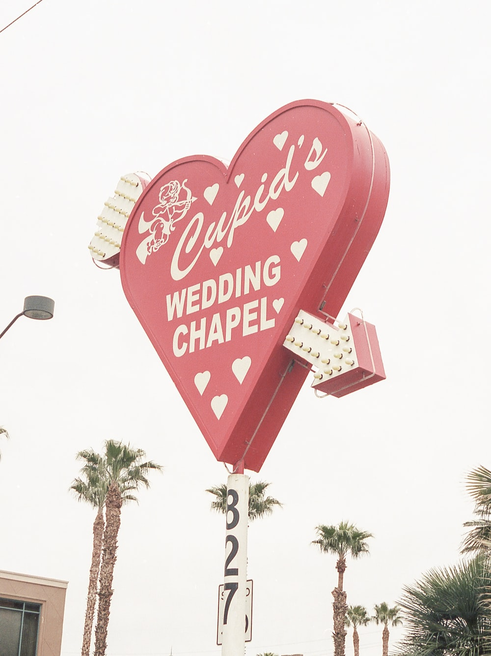 red and white love me heart shaped signage