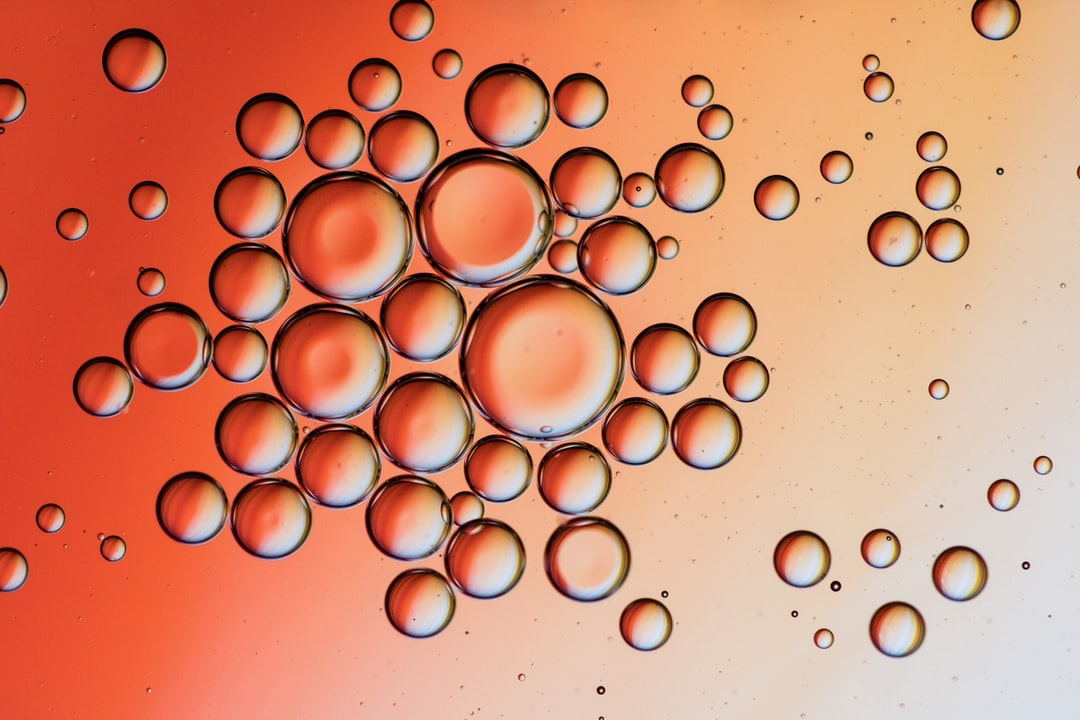Water Droplets On Red Surface - unsplash
