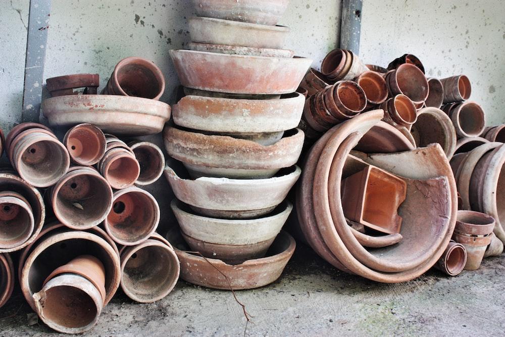 brown clay pots on gray concrete floor