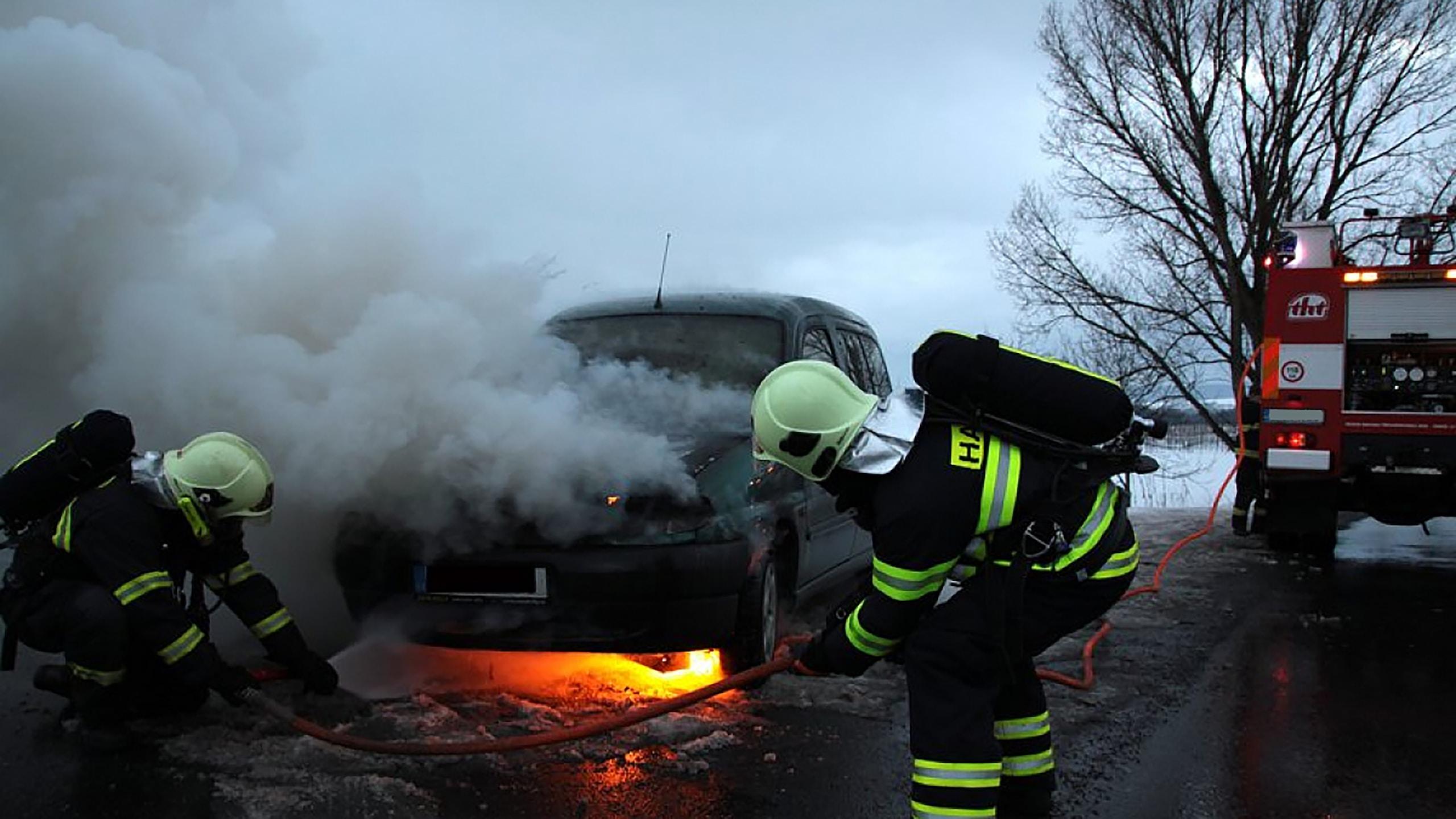 man in black helmet and black helmet standing on fire